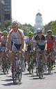 Riders race down Capital Mall during the first stage of the Amgen Tour of California cycling race in Sacramento, Calif., Sunday May 10, 2015.(AP Photo/Rich Pedroncelli)