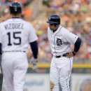 Detroit Tigers' Miguel Cabrera is approached by first base coach Omar Vizquel after pulling up while running to second base during the fourth inning of a baseball game against the Toronto Blue Jays on Friday, July 3, 2015, in Detroit. Cabrera left the game with a left calf strain and will undergo an MRI. (AP Photo/Duane Burleson)