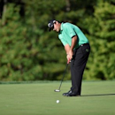 Aug 25, 2016; Farmingdale, NY, USA; Patrick Reed putts on the 10th green during the first round of The Barclays golf tournament at Bethpage State Park - Black Course. Mandatory Credit: Eric Sucar-USA TODAY Sports