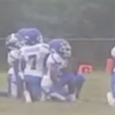 St. Louis youth football team kneels during anthem. (Facebook)