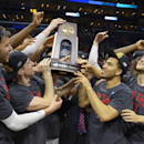 Wisconsin players hold the trophy after beating Arizona 85-78 in a college basketball regional final in the NCAA Tournament to advance to the Final Four, Saturday, March 28, 2015, in Los Angeles. (AP Photo/Mark J. Terrill)