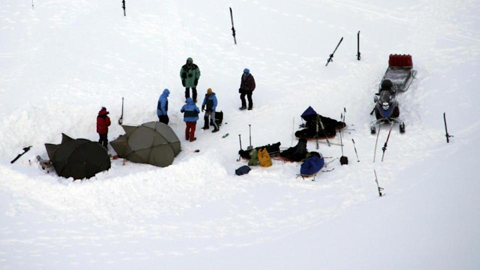 Tourists stand in the c& where a polar bear attacked in Svalbard Norway. Source Yahoo US & Polar bear attacks tent injures tourist