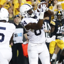 Penn State wide receiver Juwan Johnson scores against Iowa as time expires. (Jeff Roberson/AP)