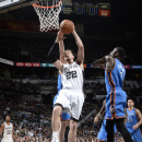 SAN ANTONIO - MARCH 25: Tiago Splitter #22 of the San Antonio Spurs goes up for a shot against the Oklahoma City Thunder at the AT&T Center on March 25, 2014 in San Antonio, Texas