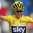 Cycling - Tour de France cycling race - The 113-km (70,4 miles) Stage 21 from Chantilly to Paris, France - 24/07/2016  - Yellow jersey leader Team Sky rider Chris Froome of Britain celebrates with team mates on the finish line.  REUTERS/Jean-Paul Pelissier