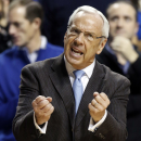 North Carolina head coach Roy Williams urges his team on during the first half of an NCAA college basketball game against Kentucky, Saturday, Dec. 13, 2014. (AP Photo/James Crisp)