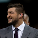 NEW ORLEANS, LA - JANUARY 01:  Former University of Florida quarterback Tim Tebow walks onto the field during the All State Sugar Bowl at the Mercedes-Benz Superdome on January 1, 2015 in New Orleans, Louisiana.  (Photo by Sean Gardner/Getty Images)