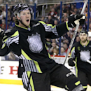 Team Foligno's Ryan Johansen of the Columbus Blue Jackets celebrates the first of his two first-period goals against Team Toews' goalie Roberto Luongo of the Florida Panthers during the NHL All-Star hockey game in Columbus, Ohio, Sunday, Jan. 25, 2015.(AP Photo/Gene J. Puskar)