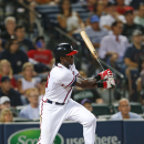 Atlanta Braves' Cameron Maybin drives in the game-winning run with a base hit in the ninth inning of a baseball game against the Washington Nationals on Thursday, July 2, 2015, in Atlanta. Atlanta won 2-1. (AP Photo/John Bazemore)