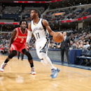 MEMPHIS, TN - NOVEMBER 17: Mike Conley #11 of the Memphis Grizzlies drives to the basket against Patrick Beverley #2 of the Houston Rockets during the game on November 17, 2014 at FedExForum in Memphis, Tennessee. (Photo by Joe Murphy/NBAE via Getty Images)