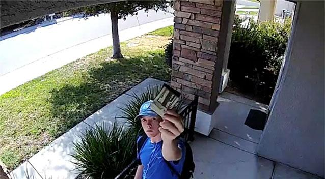 Surveillance camera catches teen returning stranger's wallet, $1500