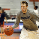 Syracuse's Trevor Cooney practices before an NCAA college basketball game against Louisiana Tech in Syracuse, N.Y., Sunday, Dec. 14, 2014. (AP Photo/Nick Lisi)