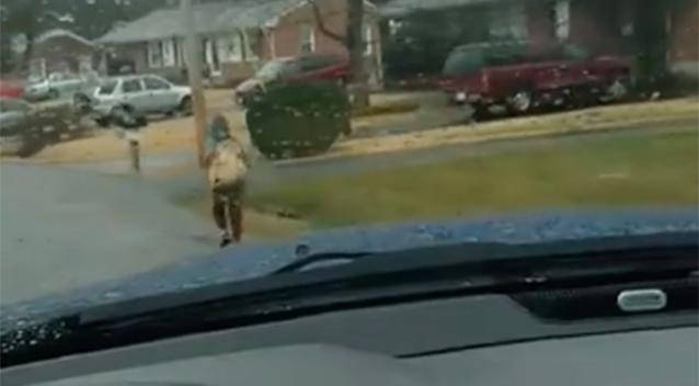 Man forces son to run to school in the rain for bullying