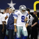 Dallas Cowboys' Tony Romo walks back onto the field to play during the second half of an NFL football game against the Washington Redskins, Monday, Oct. 27, 2014, in Arlington, Texas. (AP Photo/Tim Sharp)