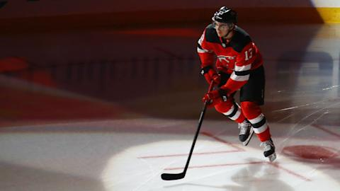 Devils throttle Sabres, 6-2, in their road opener