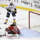 Nashville Predators' Mike Fisher (12) scores a goal past New Jersey Devils goaltender Cory Schneider during the second period of an NHL hockey game Tuesday, March 3, 2015, in Newark, N.J. (AP Photo/Bill Kostroun)