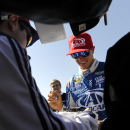 NASCAR driver Trevor Bayne signs autographs before practicing for Sunday's NASCAR auto race Friday, Feb. 27, 2015, in Hampton, Ga. (AP Photo/John Amis)