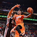 PHOENIX, AZ - OCTOBER 31: Eric Bledsoe #2 of the Phoenix Suns drives for a shot against the San Antonio Spurs on October 31, 2014 at U.S. Airways Center in Phoenix, Arizona. (Photo by Barry Gossage/NBAE via Getty Images)