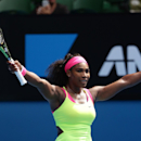 Serena Williams of the U.S. celebrates after defeating Garbine Muguruza of Spain in their fourth round match at the Australian Open tennis championship in Melbourne, Australia, Monday, Jan. 26, 2015. (AP Photo/Rob Griffith)