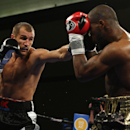 Sergey Kovalev, left, of Russia punches Cedric Agnew of Chicago, IL during the first round of WBO Light Heavyweight Championship boxing in Atlantic City, N.J. on Saturday, March 29, 2014. Kovalev won by knockout in the seventh round. (AP Photo/Tim Larsen)