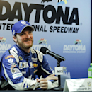 Dale Earnhardt Jr. answers questions during a news conference after qualifying for the Sprint Cup Series was cancelled at Daytona International Speedway, Saturday, July 4, 2015, in Daytona Beach, Fla. Earnhardt will start on the pole for the race. (AP Photo/Terry Renna)