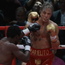 US actor Mickey Rourke, right, holds up his guard against his opponent Elliot Seymour of the United States, during their professional boxing match, at the Luzhniki Stadium, Moscow,Friday, Nov, 28, 2014. Hollywood actor Mickey Rourke returned to the boxing ring Friday at the age of 62, defeating a fighter less than half his age in an exhibition bout. (AP Photo/Ivan Sekretarev)