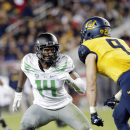 FILE - In this Friday, Oct. 24, 2014 file photo, Oregon defensive back Ifo Ekpre-Olomu during an NCAA college football game against California in Santa Clara, Calif. Oregon coach Mark Helfrich confirmed Thursday, Dec. 18, 2014 that the third-ranked Ducks will be without star cornerback Ifo Ekpre-Olomu when they face Jameis Winston and Florida State in their playoff game next month. (AP Photo/Marcio Jose Sanchez, File)