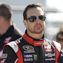 In this Sunday, Feb. 15, 2015, photo, Kurt Busch stands on pit road prior to qualifying for the Daytona 500 NASCAR Sprint Cup series auto race at Daytona International Speedway in Daytona Beach, Fla. NASCAR suspended Busch indefinitely on Friday, Feb. 20, after a judge said the former champion almost surely strangled and beat an ex-girlfriend last fall and there was a
