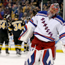 New York Rangers goalie Henrik Lundqvist (30) reacts after giving up a goal to Boston Bruins right wing Reilly Smith during the second period of an NHL hockey game, Saturday, March 28, 2015, in Boston. (AP Photo/Mary Schwalm)