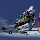 Eva-Maria Brem , of Austria, speeds down the course during the women's World Cup giant slalom ski race Saturday, Nov. 29, 2014, in Aspen, Colo. (AP Photo/John Locher)