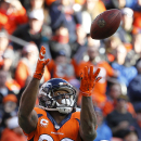 Denver Broncos wide receiver Demaryius Thomas (88) pulls in a pass to set up a touchdown run against the Oakland Raiders during the first half of an NFL football game, Sunday, Dec. 28, 2014, in Denver. (AP Photo/Jack Dempsey)