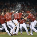 Aug 28, 2014; Anaheim, CA, USA; The Los Angeles Angels celebrate after a sacrifice fly hit by Los Angeles Angels second baseman Howie Kendrick (47) during the 10th inning against the Oakland Athletics at Angel Stadium of Anaheim. The Los Angeles Angels defeated the Oakland Athletics 4-3. (Kelvin Kuo-USA TODAY Sports)