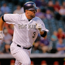 DENVER, CO - SEPTEMBER 18:  Michael Cuddyer #3 of the Colorado Rockies rounds the bases on his solo home run off of starting pitcher Vidal Nuno #54 of the Arizona Diamondbacks to give the Rockies a 1-0 lead in the second inning at Coors Field on September 18, 2014 in Denver, Colorado.  (Photo by Doug Pensinger/Getty Images)