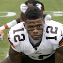 Cleveland Browns' Josh Gordon (12) before an NFL football game against the Carolina Panthers in Charlotte, N.C., Sunday, Dec. 21, 2014. The Panthers won 17-13. (AP Photo/Bob Leverone)