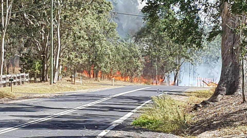 Locals flee burning seaside NSW town