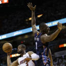 Miami Heat's Dwyane Wade (3) passes the ball as Charlotte Bobcats' Bismack Biyombo (0) defends during the first half in Game 1 of an opening-round NBA basketball playoff series, Sunday, April 20, 2014, in Miami. (AP Photo/Lynne Sladky)