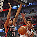 CHICAGO, IL - APRIL 18: Derrick Rose #1 of the Chicago Bulls leaps to pass under pressure from John Henson #31 and Michael Carter-Williams #5 of the Milwaukee Bucks during the first round of the 2015 NBA Playoffs at the United Center on April 18, 2015 in Chicago, Illinois. The Bulls defeated the Bucks 103-91. (Photo by Jonathan Daniel/Getty Images)