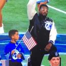 Anthem singer in Detroit takes knee while singing