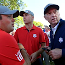 Sep 30, 2016; Chaska, MN, USA;  Jordan Spieth of the United States and  Patrick Reed of the United States talk with Team USA captain Davis Love III in the morning foursome matches during the 41st Ryder Cup at Hazeltine National Golf Club. Mandatory Credit: Michael Madrid-USA TODAY Sports