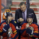 Florida Panthers interim head coach Peter Horachek, center, talks with center Quinton Howden (42) and center Jesse Winchester (17) in the second period of a hockey game against the Columbus Blue Jackets, Saturday, April 12, 2014, in Sunrise, Fla. (AP Photo/Lynne Sladky)