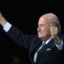 FIFA president Sepp Blatter gestures after his re-election during the 65th FIFA Congress held at the Hallenstadion in Zurich, Switzerland, Friday, May 29, 2015. Blatter has been re-elected as FIFA president for a fifth term, chosen to lead world soccer despite separate U.S. and Swiss criminal investigations into corruption. The 209 FIFA member federations gave the 79-year-old Blatter another four-year term on Friday after Prince Ali bin al-Hussein of Jordan conceded defeat after losing 133-73 in the first round. (Walter Bieri/Keystone via AP)