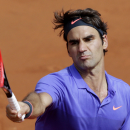 Switzerland's Roger Federer returns the ball to Bosnia and Herzegovina's Damir Dzumhur during their third round match of the French Open tennis tournament at the Roland Garros stadium, Friday, May 29, 2015 in Paris. Federer won 6-4, 6-3, 6-2. (AP Photo/Thibault Camus)