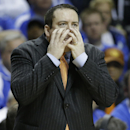 FILE - In this March 13, 2015, file photo, Tennessee head coach Donnie Tyndall calls a play against Arkansas during the first half of an NCAA college basketball game in the quarterfinal round of the Southeastern Conference tournament in Nashville, Tenn. Tennessee has fired basketball coach Donnie Tyndall after one season. Tyndall's firing comes as the NCAA investigates his two-year stay at Southern Mississippi, where he coached before coming to Tennessee last year. Tennessee athletic director Dave Hart said in a statement Friday, March 27, 2015, it is