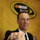 Kevin Harvick poses with his championship ring during the NASCAR Sprint Cup Series auto racing awards at Wynn Las Vegas Friday, Dec. 5, 2014, in Las Vegas. (AP Photo/Isaac Brekken)