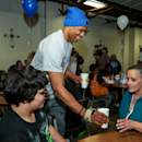 OKLAHOMA CITY, OK - NOVEMBER 24: Russell Westbrook of the Oklahoma City Thunder serves a holiday meal to clients at the City Rescue Mission and participates in a carnival for families of the shelter on November 24, 2014 at the City Rescue Mission Shelter in Oklahoma City, Oklahoma. (Photo by Layne Murdoch Jr./NBAE via Getty Images)