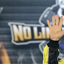 Matt Kenseth waves in Victory Lane after taking the pole position for Sunday's NASCAR Sprint Cup Texas 500 auto race at Texas Motor Speedway in Fort Worth, Texas, Friday, Oct. 31, 2014. (AP Photo/LM Otero)