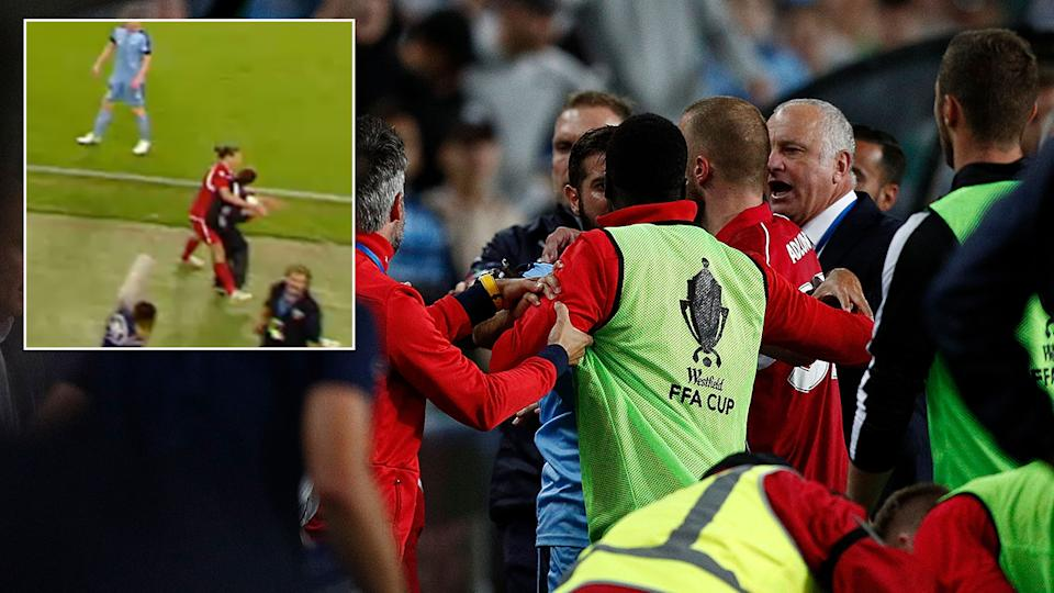 Wild scenes ensued after the ballboy hit the ground. Pic Getty  Fox Sports