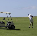 A Canadian tourist plays golf at a course in Varadero, a 12-mile-long peninsula of white sand beaches lined with resorts in the province of Matanzas, around 135 kilometres (84 miles) from Havana May 22, 2010.  REUTERS/Enrique De La Osa