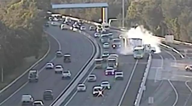 Heart stopping moment school bus and truck almost collide on Sydney's M5