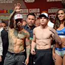 Nov 20, 2015; Las Vegas, NV, USA; Miguel Cotto (left) and Canelo Alvarez (right) pose for a photo during weigh-ins for their upcoming WBC middleweight title fight at Mandalay Bay. Mandatory Credit: Joe Camporeale-USA TODAY Sports